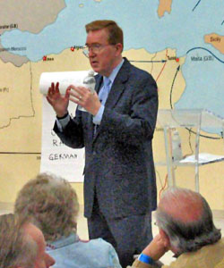 Ed Gordon speaking in front of a crowd