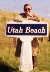 Ed Gordon standing at Utah Beach sign