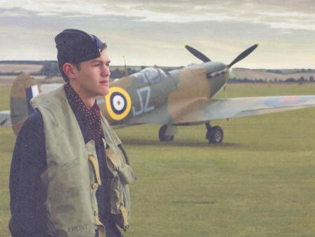Pilot next to airplane during Battle of Britain