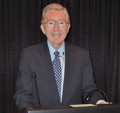 Edward E. Gordon behind presentation podium